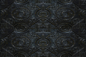 An ornate, black ceiling tile.