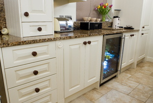 A wine cooler in a kitchen.