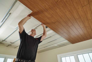 man installing ceiling planks