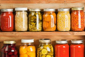 Home Canning of Summer Vegetables on Shelves Hz