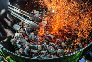 Coals with heat and sparks.