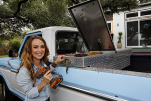 woman standing next to toolbox in back of a truck