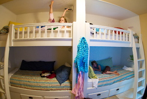 White bunk beds with a ladder.