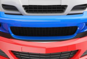three plastic bumper fascia covers