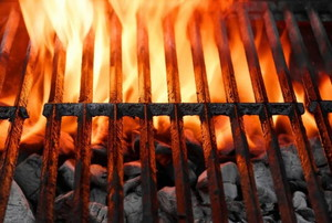 flames rising from a charcoal grill