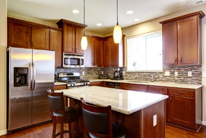A kitchen with dark wood cabinets.