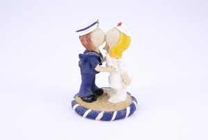 An acrylic nurse and sailor statue.