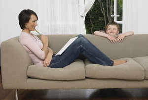 Mother and son around a sofa