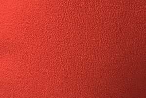 A close-up view of a swatch of red polar fleece.