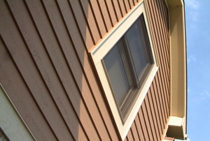 side of a house looking up into the roofline