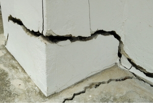 A crack in a concrete slab foundation.