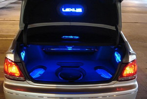 The inside of a car trunk and its back lights.