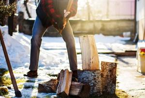 A man chops firewood.