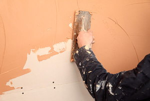 putting being spread over a plaster wall