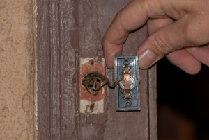 Person removing a doorbell button