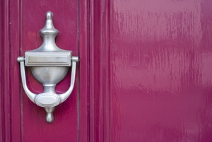 burgundy colored door with silver door knocker