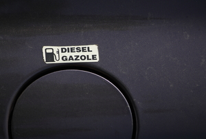 A diesel gasoline sticker above the gas tank opening.