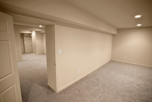 A renovated basement space with white walls.