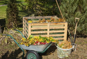 compost pile with containers of organic material next to it