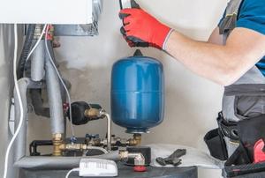 man installing gas furnace