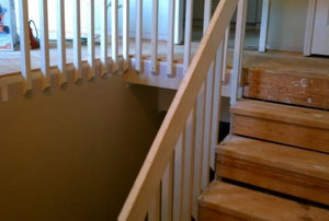 Several unfinished wooden stair treads of a two-story home.