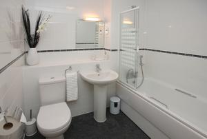 bathroom with tile shower