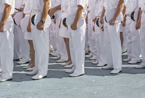 Rows of soldiers dressed in white Navy uniforms
