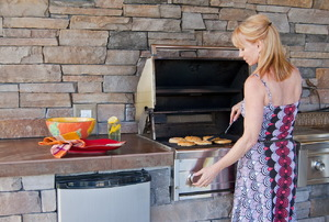 A woman at a BBQ.