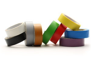 Many different colored rolls of electrical tape sit against a white background.