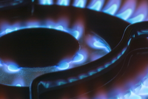 gas burner on a stove lit in the dark