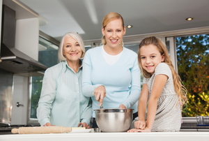 Three generations of women in a kitchen.