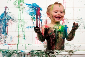 kid playing with paint