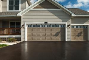 Fresh asphalt driveway and home exterior.