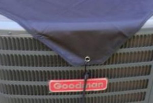 an outside AC condenser with a cover on it