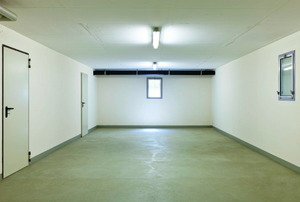 an empty, well lit basement