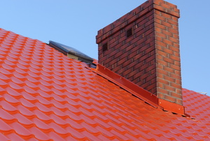 a red roof with brick chimney