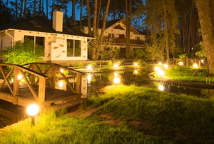 landscape lights outside a cozy lakehouse