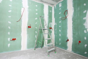 room with sheetrock, taped, and mud walls