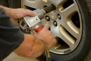 Using an impact wrench to remove lug nuts