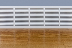 baseboard heater in a room with wood floor