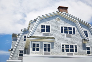 A home with a gambrel roof.