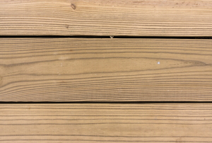 Several planks of pressure treated wood decking.