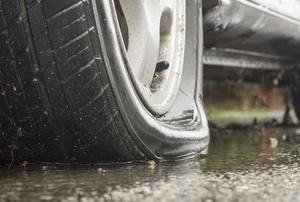 a flat tire on wet concrete