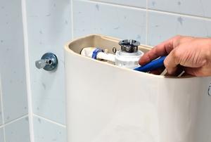 hand fixing internal toilet mechanisms