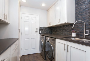 A laundry room with a washer and dryer.