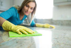 woman wiping down a countertop