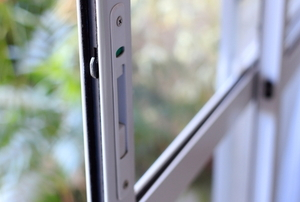 a sliding glass door with a lock mechanism