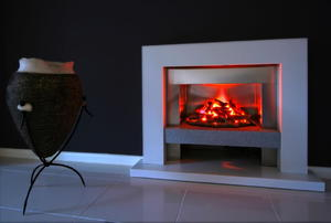 A modern fireplace with a fire going.