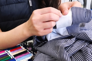a woman altering a piece of clothing