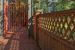 Wood fence and metal gate